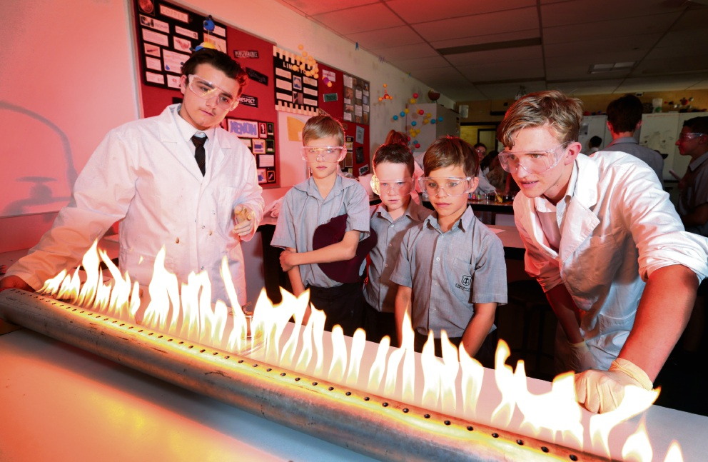 Jarryd Brooks, Bailey Brandt and Jordan Broun take part in the Science Fair. Bailey Meldrum, Saxon Colwell and Max Frisina watch Liam Brien (left) and Isaac Arnold at a demonstration. Pictures: David Baylis        www.communitypix.com.au   d463210