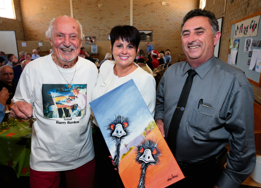 Artist Harry Barden, Alyssa Hayden MLC and Swan Mayor Mick Wainwright. Harry presented Mrs Hayden with the painting as a thank you for her efforts in securing new premises for the Midland Men's Shed. Picture: David Baylis d462125
