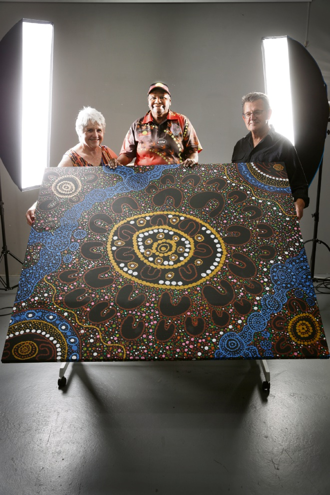 Anne Barrett, artist Neta Knapp and Rees Barrett hold the painting that signifies local support for the Create Ranger Parks project.  Picture: Andrew Ritchie  d463529