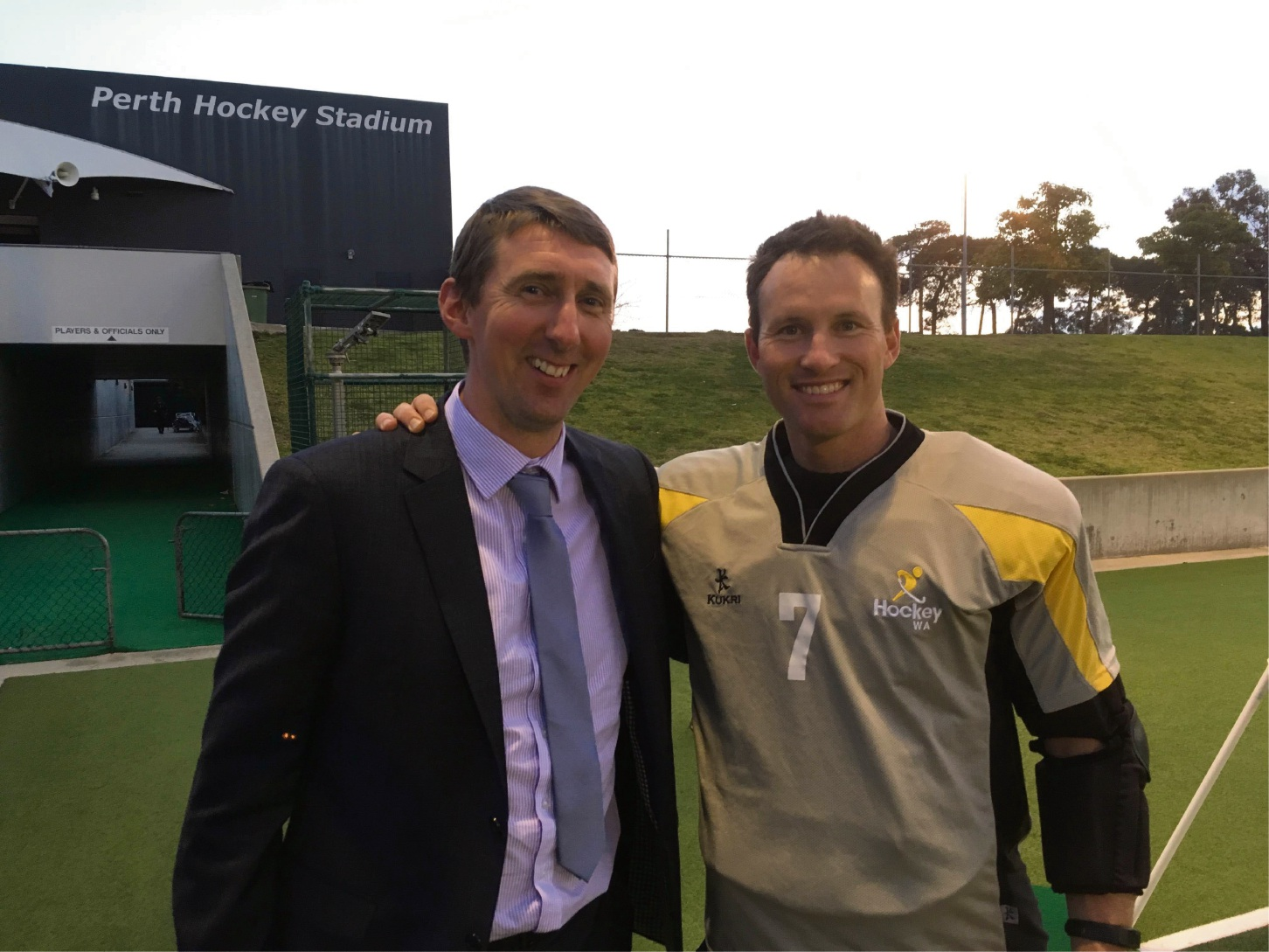 Richard Davies with Australian hockey player Tyler Lovell.
