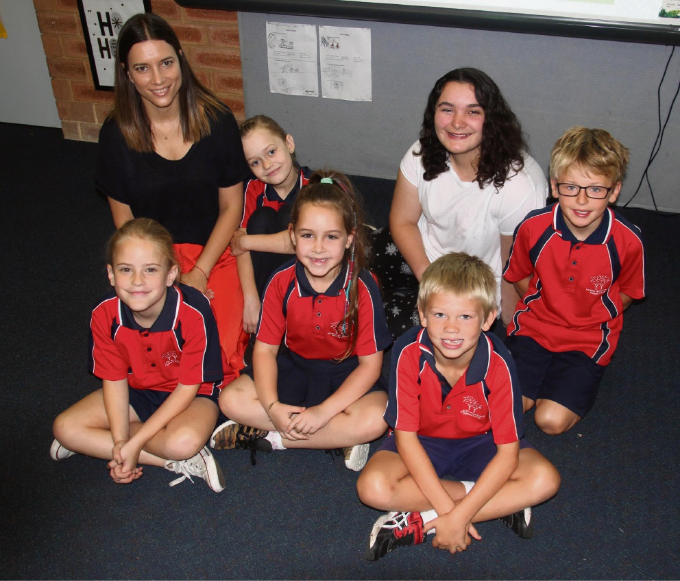 Asha Melville (back row in white shirt) with students of North Woodvale Primary.