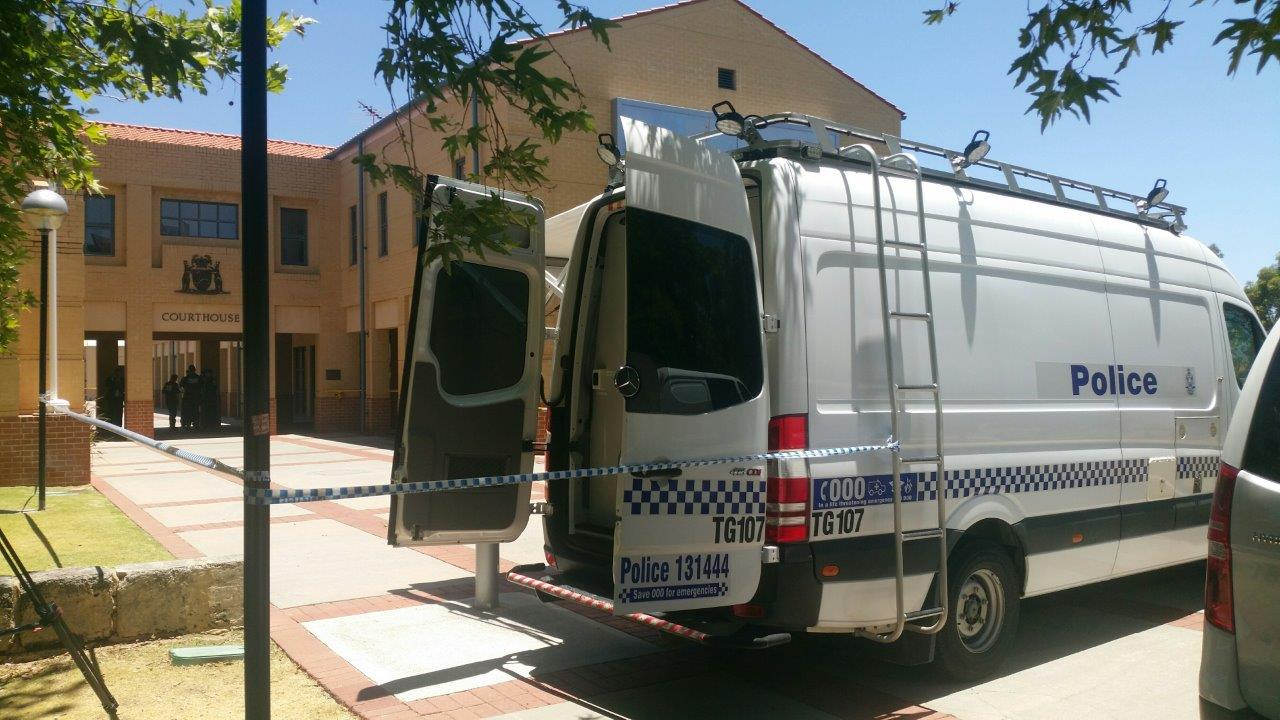 Forensic police set up at the Joondalup Courthouse after today's fatal stabbing.