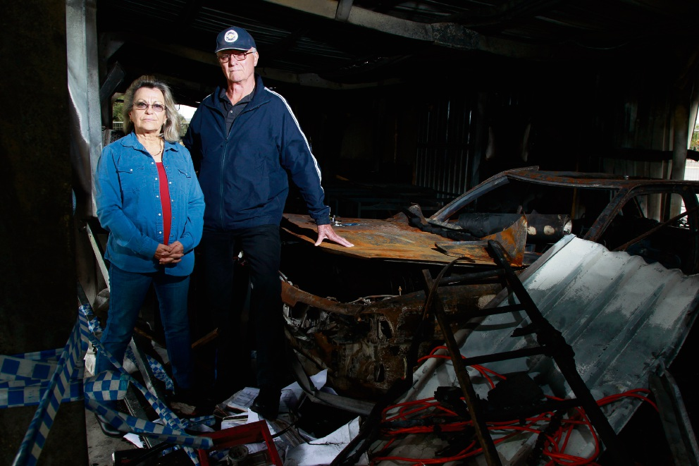 Elaine Napier and Ray Houlcroft of the Gosnells Archers club, standing in the aftermath of their building after a car smashed into it and was set on fire. Picture: Marie Nirme