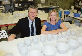 Small Business Commissioner David Eaton looks checks out Carlisle-based Eucalypt Homewares Melanie Sharpham's warehouse.