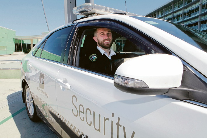 Security Officer Shaun Cheney in one of the City's Toyota Camry Hybrid cars. Picture: Michael Gill.