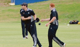 Stewart Walters takes Jack Baker's hat in last years Premier Cricket season.
