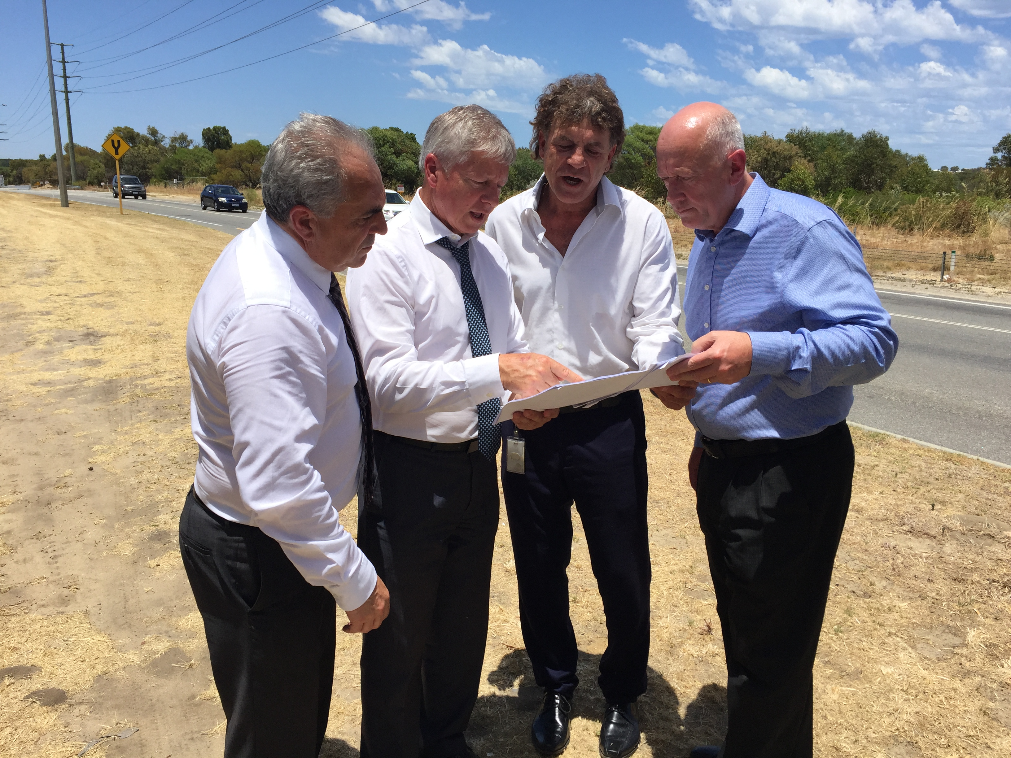 Transport Minister Bill Marmion, second left, with Wanneroo MLA Paul Miles at the announcement this morning.