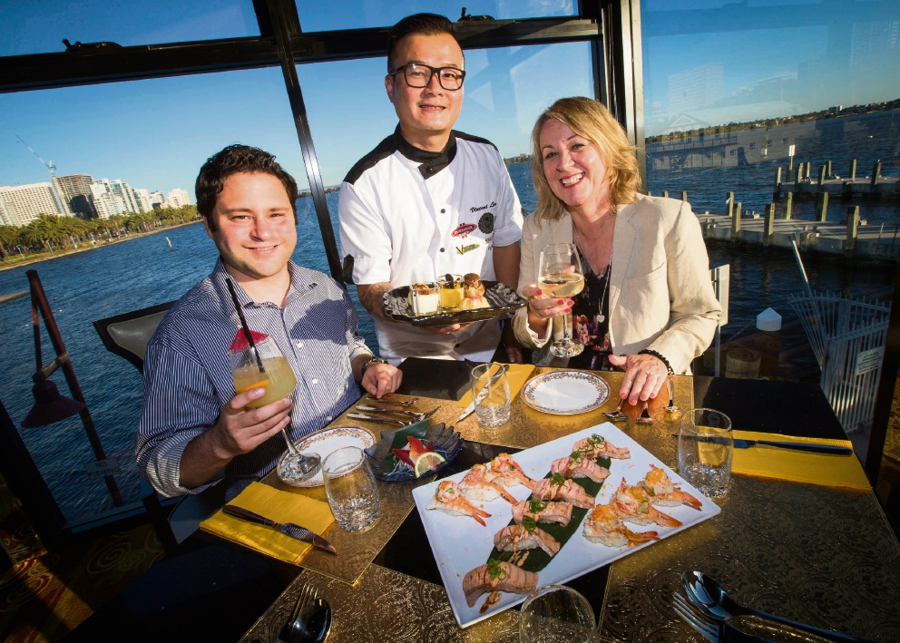 Volunteer Andrew Lyons with chef Vincent Lim and volunteer Debra Barnes. Picture: Matt Jelonek