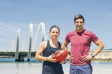 Fremantle Dockers legend Matthew Pavlich (right) and women's team marquee player Kiara Bowers will put the footy skills of Port Coogee locals to the test.