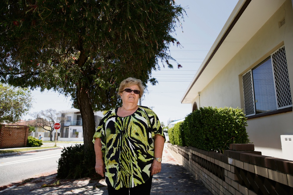 Angela Antonelli said the bottlebrush tree near her yard is upsetting her asthma and damaging her drainage. Picture: Andrew Ritchie