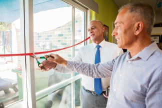 Derrick Ernst's sons Jeff and Derrick cut the ribbon at the opening. Picture: f4 Photography