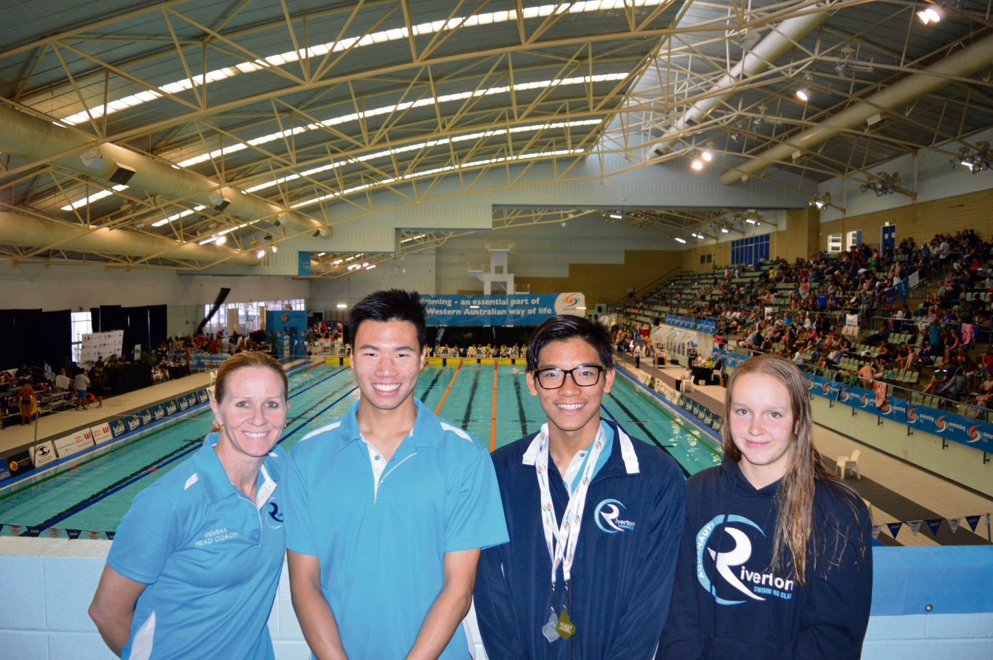 Head coach Gemma Herrington with Joseph Reagan (18), Andrew Nguyen (14) and Kaitlin Williams (13).