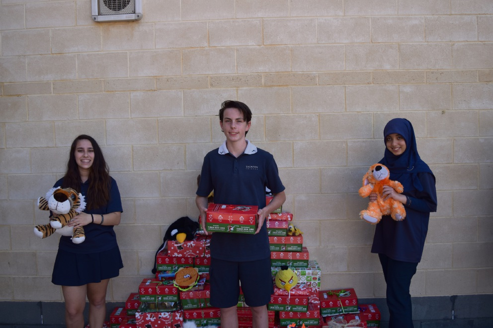 Year 9 students Natasha Ronzan, Eli Cumming and Muminah Gilani have helped make the Christmas boxes.