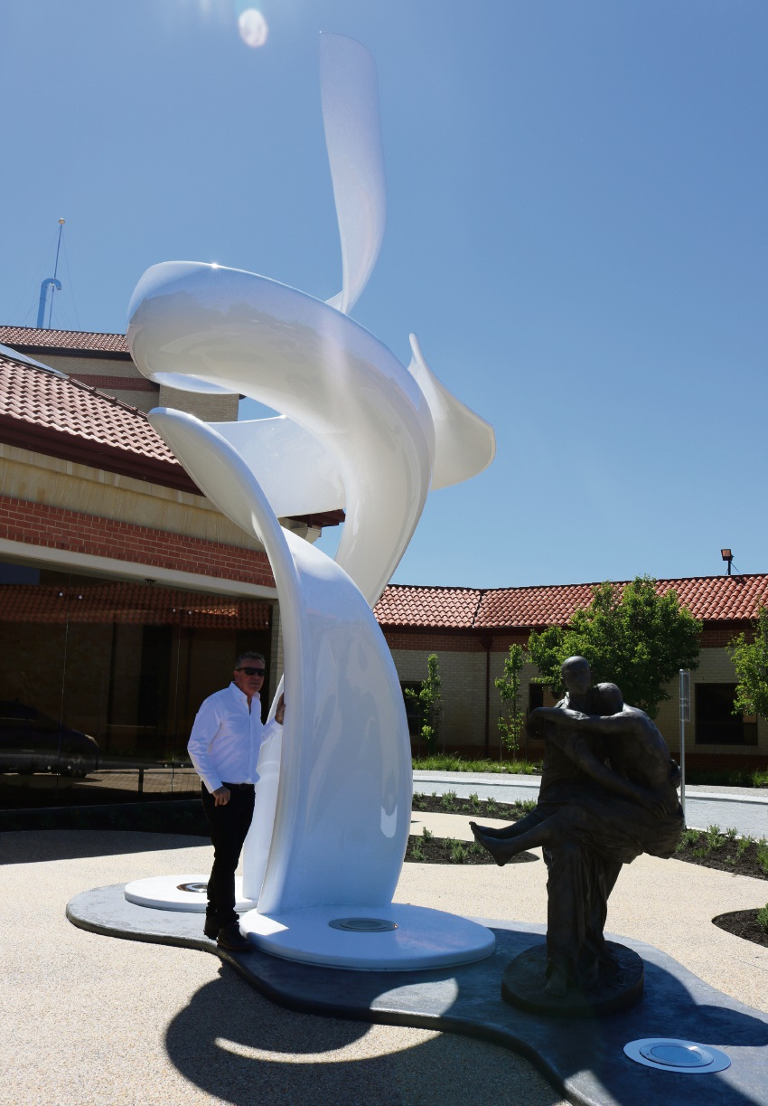 Artist Jon Tarry alongside his new sculpture at St John of God Murdoch.