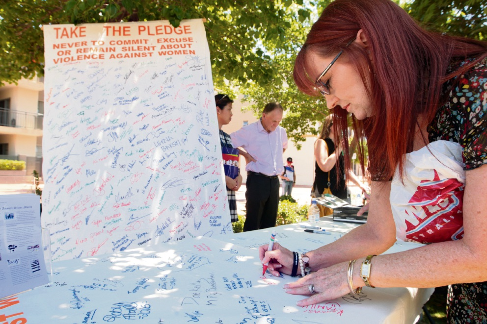 White Ribbon Day march through Midland hears calls for prevention of violence against women