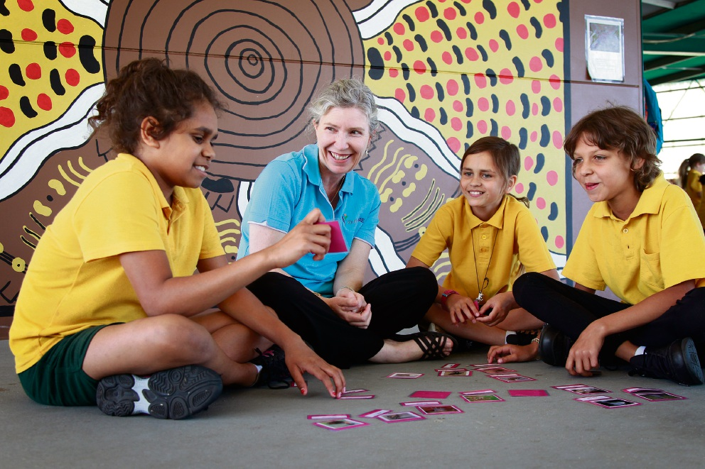 School chaplain Christine Thomas with Thornlie Primary School students Shanisha Yarran (11), Rhiana Toomath (10) and Shelea Krakouer (10) playing a card game. Picture: Marie Nirme