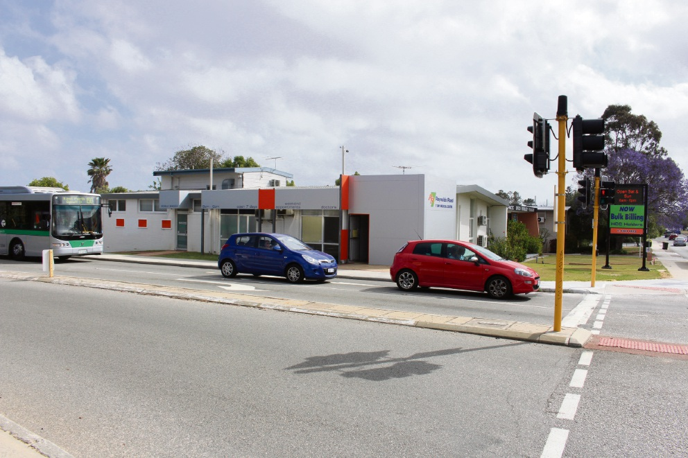The site of a proposed new Woolworths on the corner of Reynolds Road and Canning Highway.