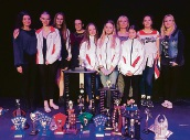 Footwork Dance Company members with the swag of awards they won at the Kwinana Dance Festival.