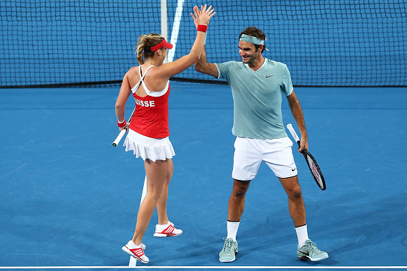 Roger Federer and Belinda Bencic of Switzerland celebrate after winning a point during the mixed doubles match against Alexander Zverev and Andrea Petkovic of Germany at the 2017 Hopman Cup. Picture: Paul Kane/Getty Images.