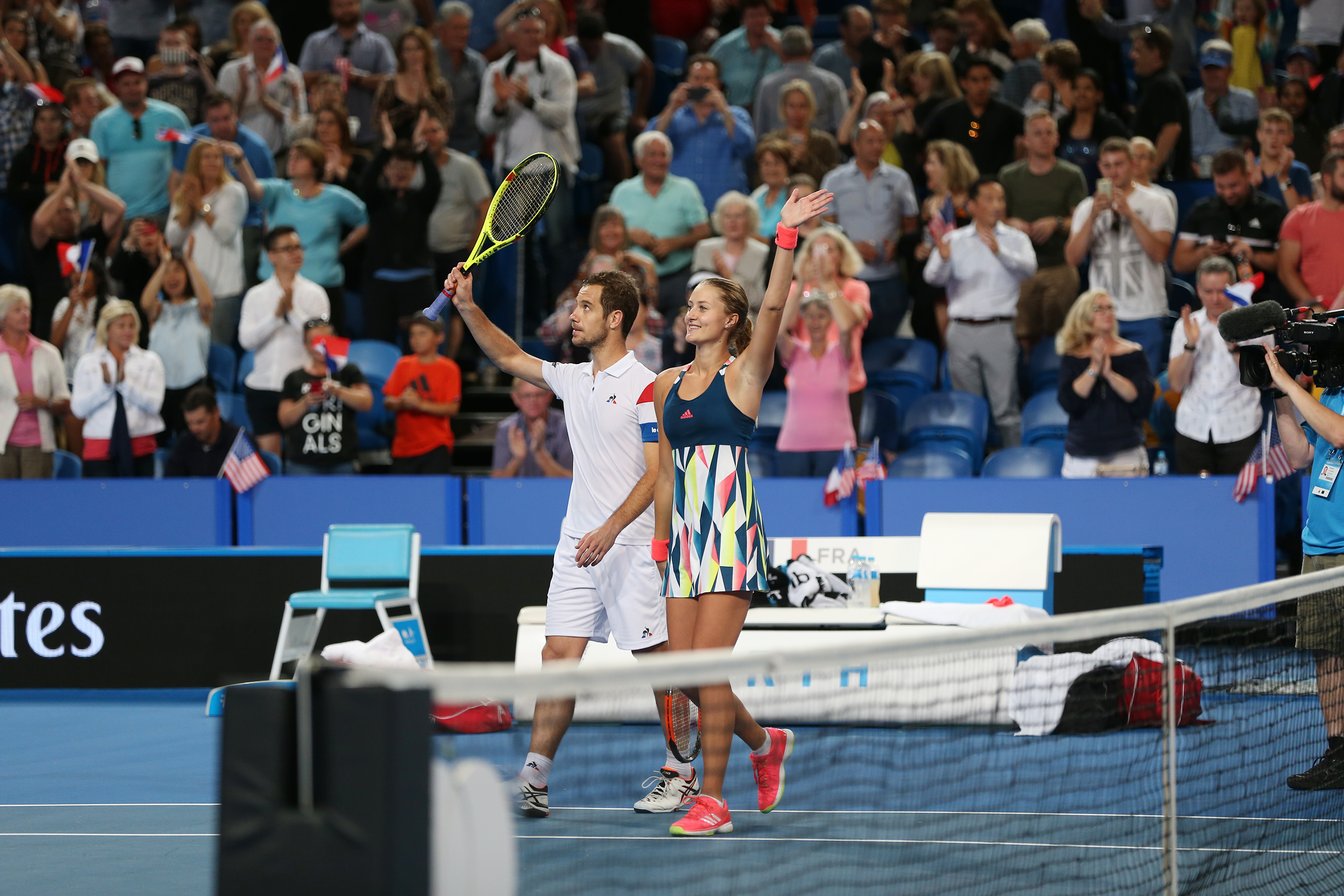 Kristina Mladenovic and Richard Gasquet (France) celebrate the win
