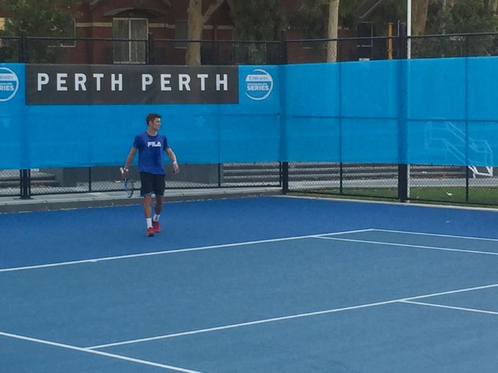 Matt Ebden on the practise court with Roger Federer.