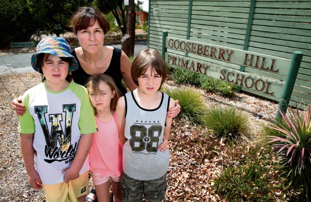Diana Archer with her children Morgan (9), Hayden (8) and Wyatt (10). Picture: David Baylis  d463697