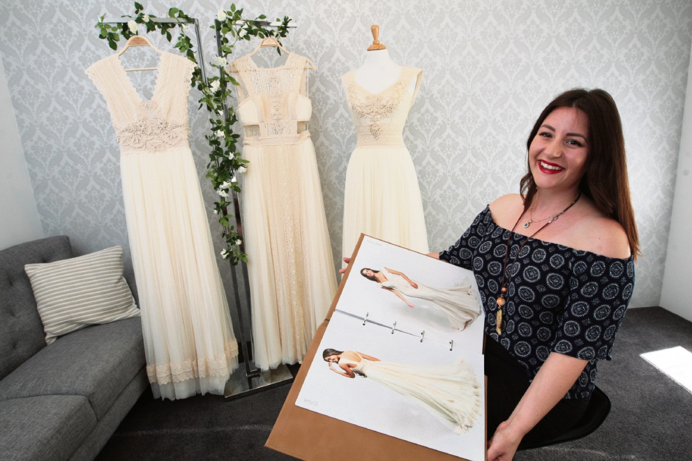 Sophie Linardopoulos with some wedding dress designs. Picture: Bruce Hunt         www.communitypix.com.au   d462982