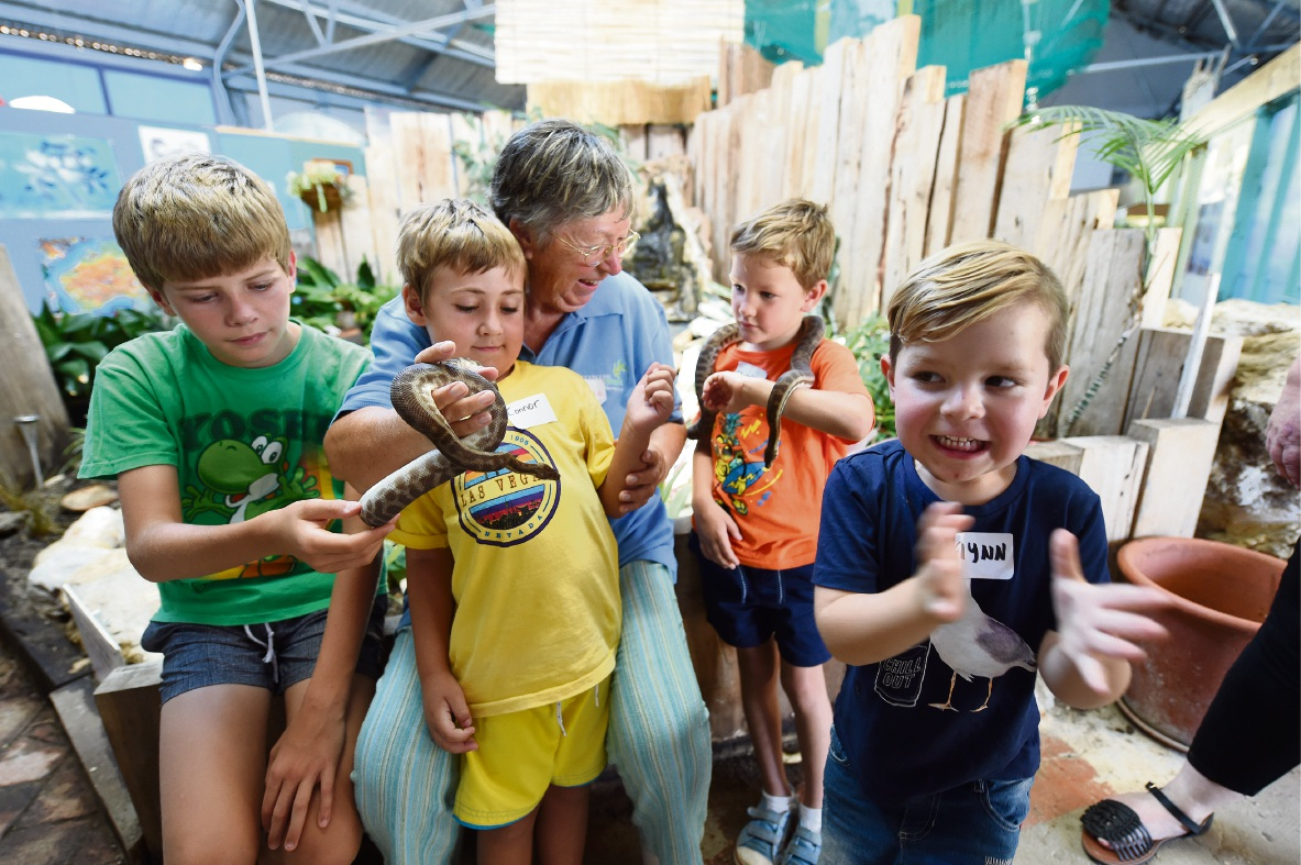 Volunteer Pauline Whitehead with snake-handling children Griffin Davenport, Connor Morrison, Christian Wenman and Flynn Hulton. Picture: Jon Hewson        d463883