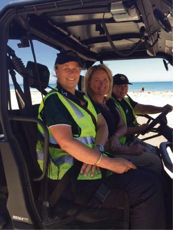 Sarah Wilson, Mayor Marina Vergone and Rebecca Webb put the Green Ranger through its paces at Doddis Beach.