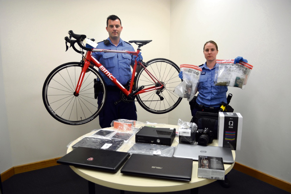 Constable Luke Smith and First Class Constable Ciara Heffernan with the stolen goods. |Picture: Toyah Shakespeare