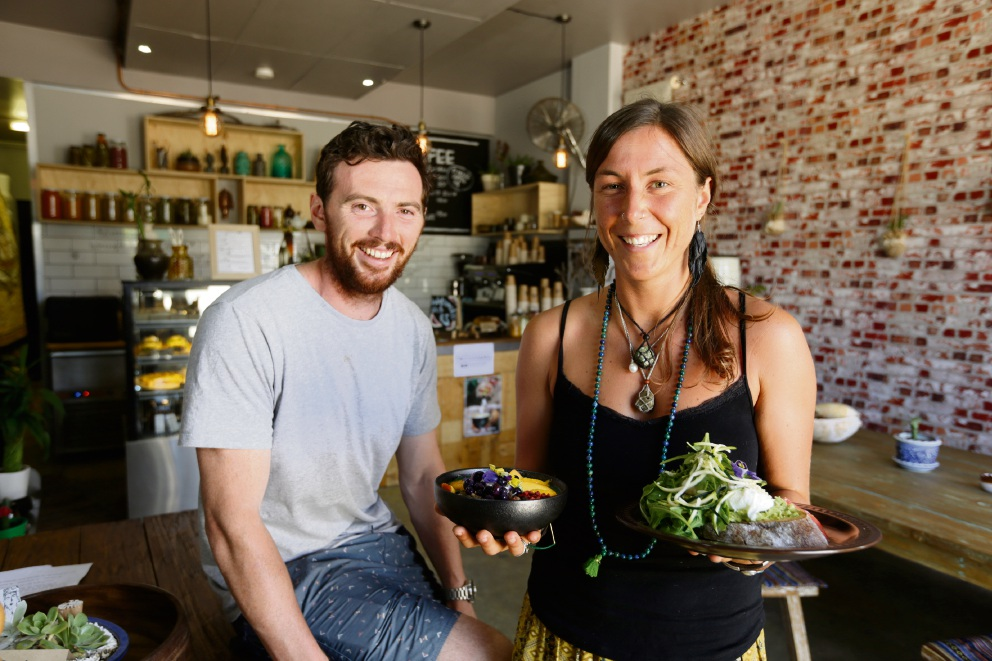 Conscious cafe Pachamama owners Damian Sullivan and Jac Olsen. Left: A smoothie bowl.