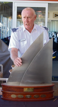 Commodore Chris Grant accepts the North Coast Series trophy in 2014.