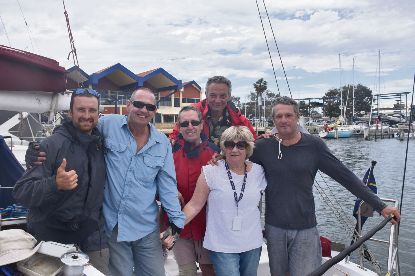 Pandora crew sailed in a mark of respect to Chris Grant … pictured after the race are Sandy Grant, Seb Venaille, Terry Mather, Phil Maslen, Rob Bortot and Jeremy Grant.