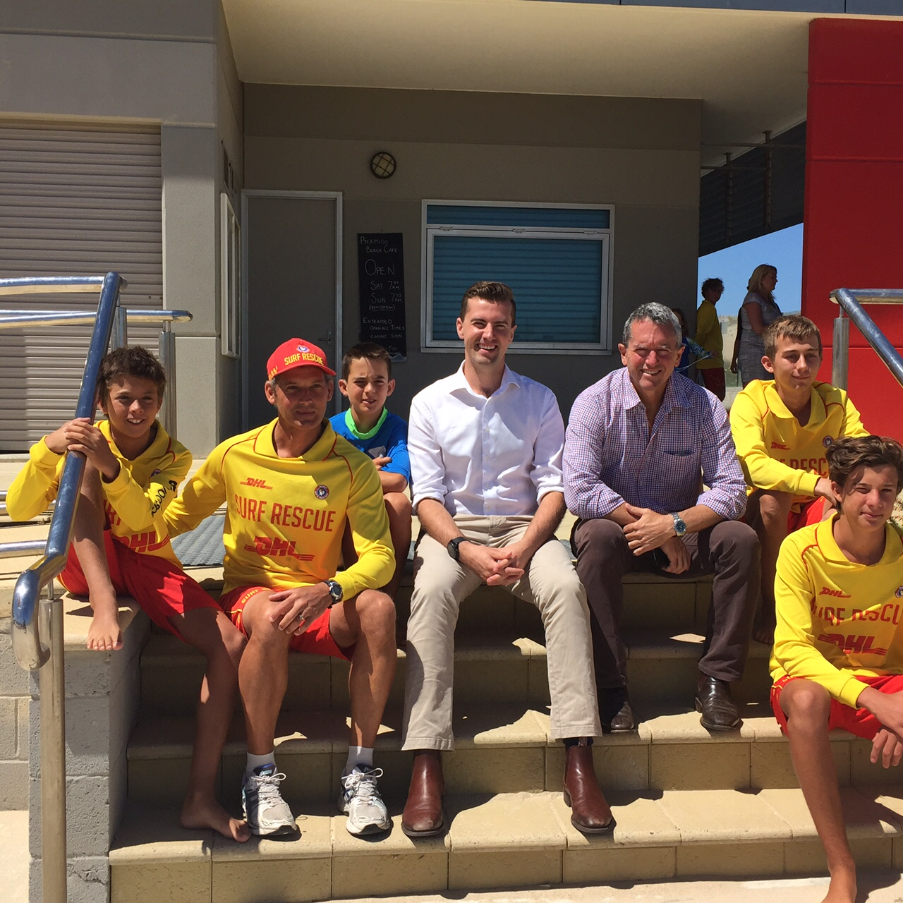 Regional Development Minister Terry Redman (right) and Dawesville Liberal candidate Zac Kirkup with a group of young surfers at the launch.