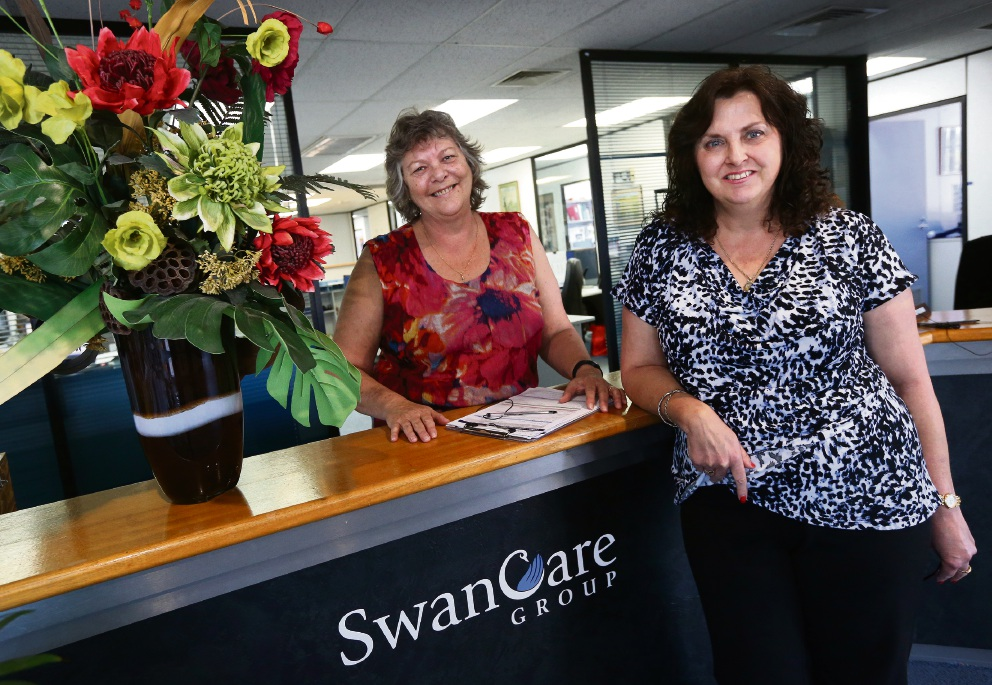 Long-term employees Kim George and Joy Sullivan at SwanCare. Picture: Matt Jelonek