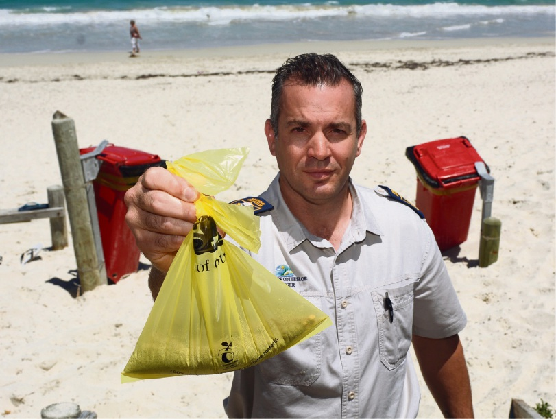 Put it in the bags and the red bins says Cottesloe ranger Neil Reeves. Picture: Jon Bassett.