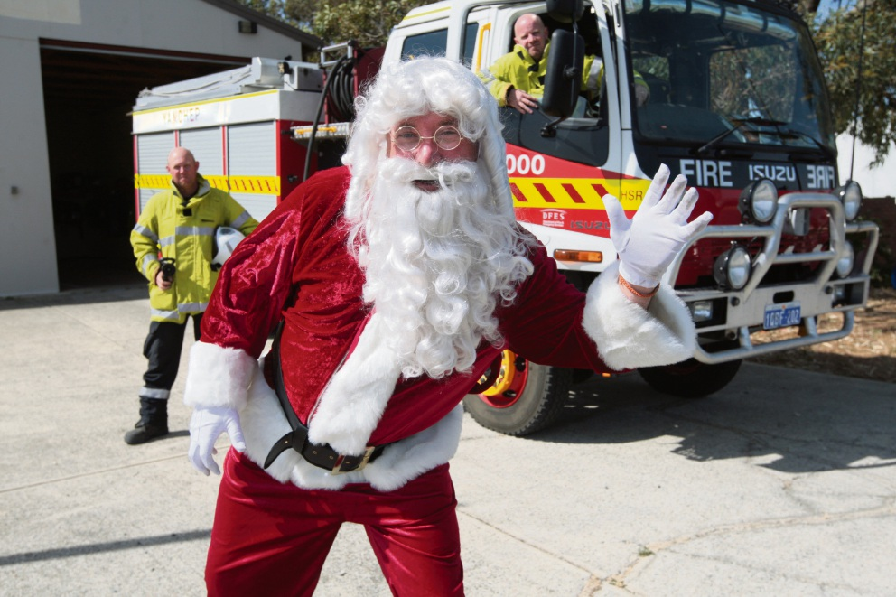 Santa (Charlie Hemsley) with Craig Smith and Dean Holmes. Picture: Bruce Hunt