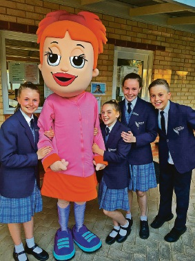Year 6 students Alayna Grubb, Caitlin Moffitt, Zoe Wise and Liam Pabst with the Dollarmites school banking mascot.