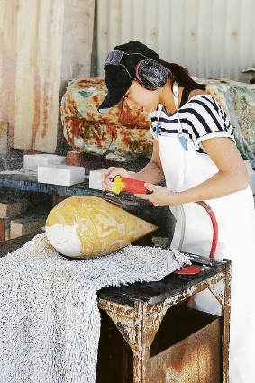 Jina Lee at work. Picture: Peter Zuvela