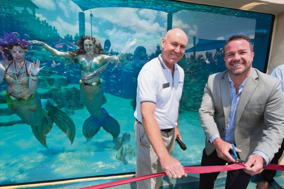 AQWA general manager John Lowe and Joondalup Mayor Troy Pickard with mermaids at the opening. Picture: Bruce Hunt d464116