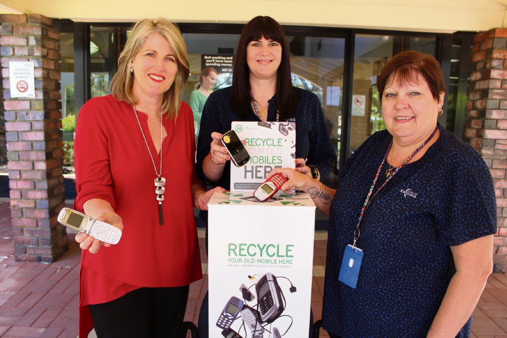 Kwinana Mayor Carol Adams and administration staff Meredith Troeger and Linda Barnett with some old phones.