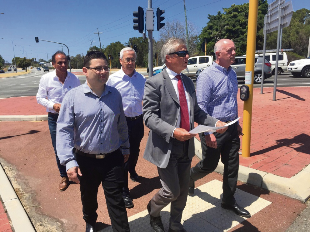 Transport Minister Bill Marmion at the intersection with Wanneroo MLA Paul Miles, local Liberal candidates and Wangara landowner Chris Sarros (back).