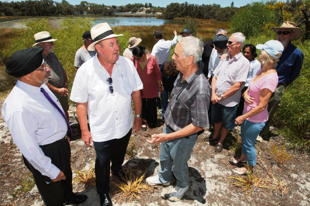 South Perth MLA John McGrath (in white short sleeve shirt and hat) meets Sukhwant Singh (left), Frank Giancristofaro and other residents at the lagoon recently.  Picture: Bruce Hunt        d464171