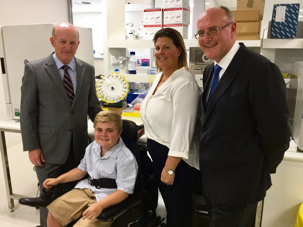Health Minister John Day at Pathwest with Logan Bayley and his mother Klair and chief pathologist Dominic Mallon.