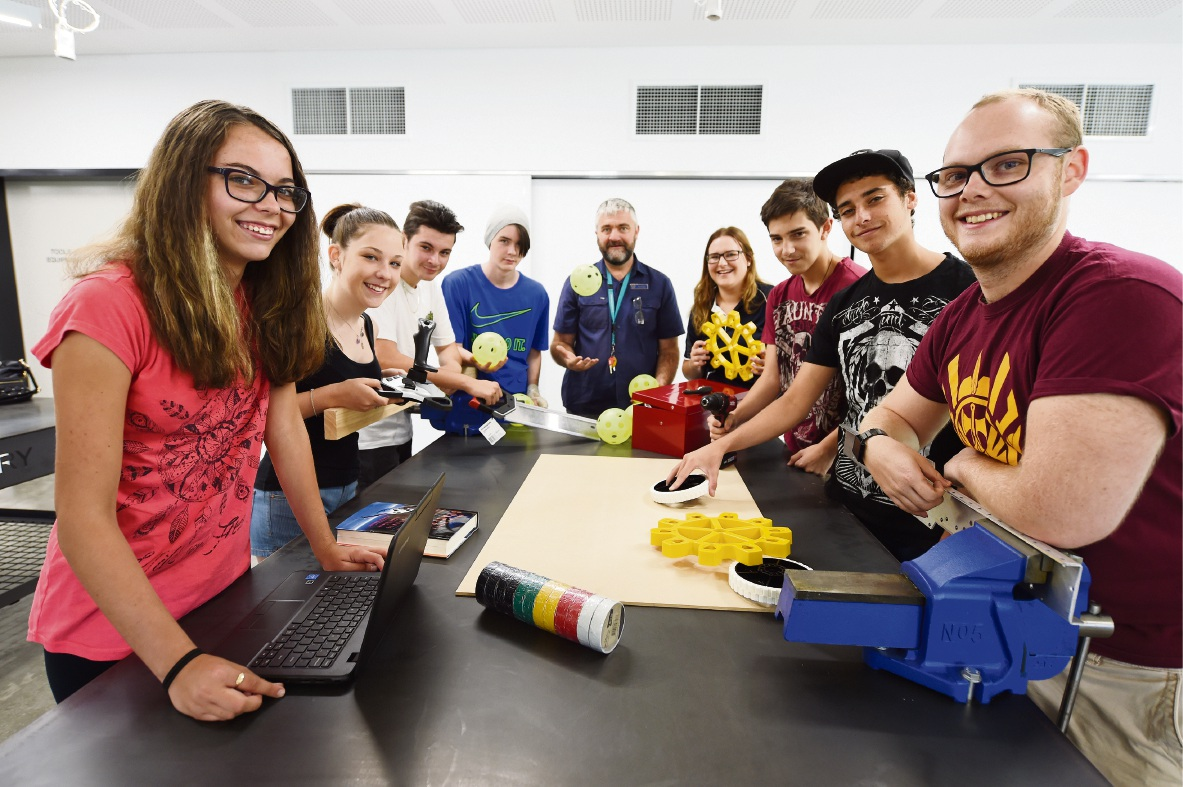 From left: Kayla Roemer-Hanisch, Isabella Bulich, Matthew Hannah, Benn Myles, technology teacher John Townley, Amy Thomas, Zack Rowan, Nathan Gusman and Anthony Pyle.