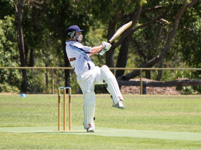 Fifth-grade batsman Aaron Ballantyne hits another boundary on Saturday.