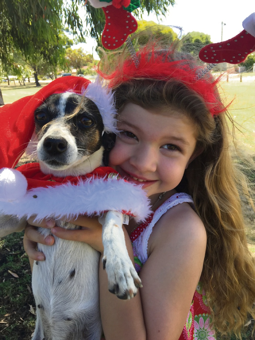 Caitie Hughes (6), with her dog Piglet, has become far more self-confident.