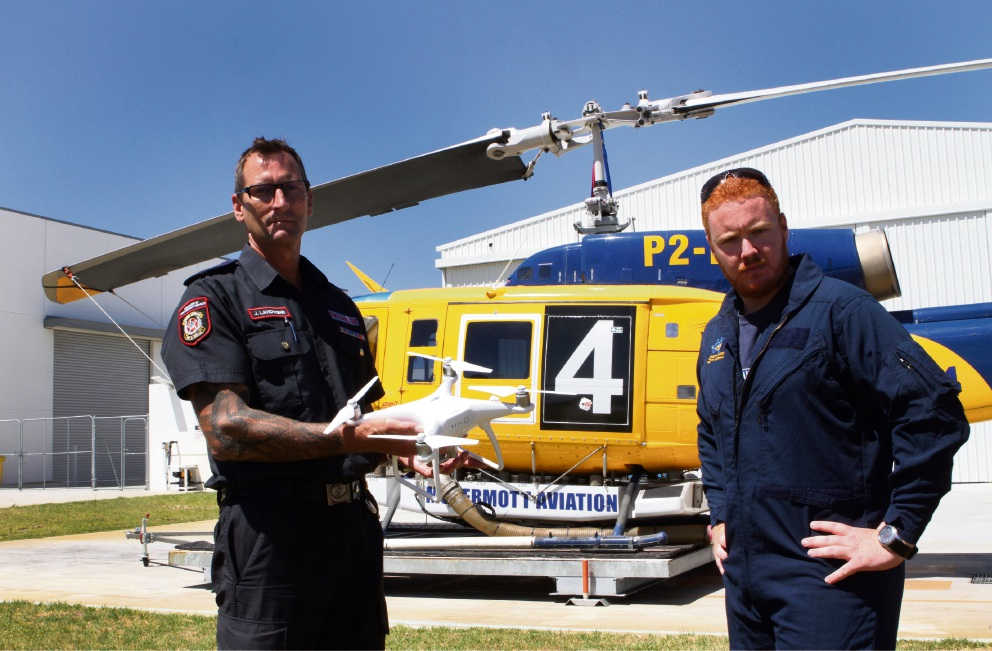 DFES officer John Landwehr and Capt Jackson Stapleton, from McDermott Aviation. Picture: Robin Kornet         d464408