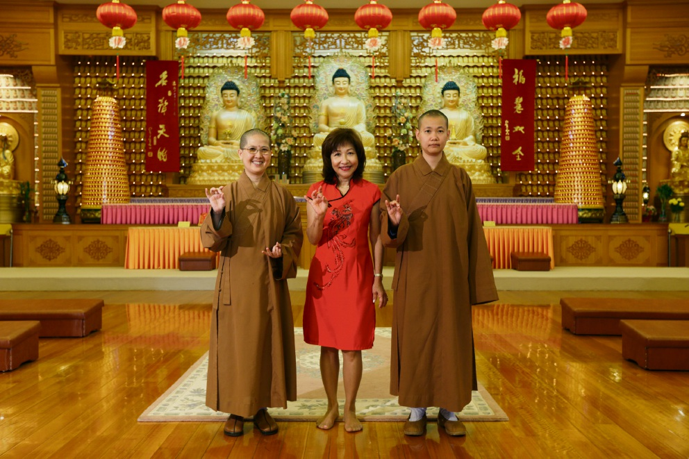 Venerable Juedi, Grace Collins and Venerable Miao Xi at the Fo Guang Shan temple.         d464277