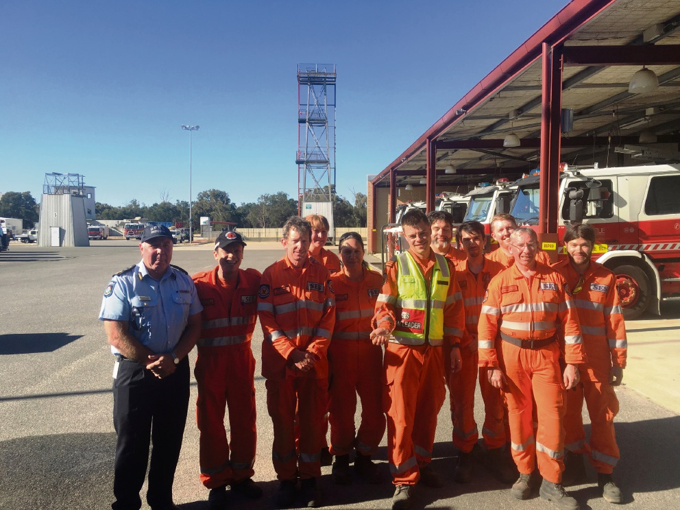 DFES metropolitan assistant commissioner Darren Klemm, with Bayswater SES team members Luan Duong, Sean O'Brien, Jane Campbell, Jo Brown, Lawrence Billson, Cary Wintle, Jason Peck, Shane Leyland, Shane Gallahar and Luke Heath.